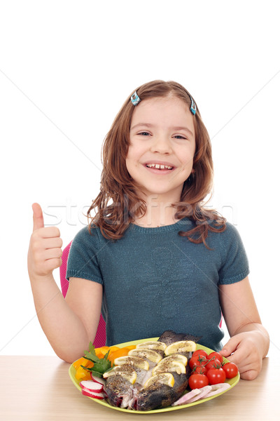 happy little girl with fish and thumb up Stock photo © goce