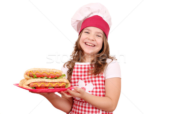 happy little girl cook with hot dogs fast food on plate Stock photo © goce