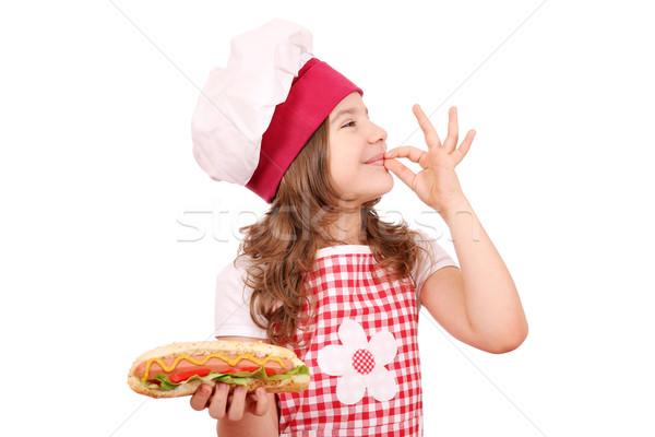 Mutlu küçük kız sosisli sandviç neden el işareti kız Stok fotoğraf © goce