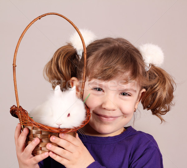 happy little girl with dwarf bunny pet Stock photo © goce