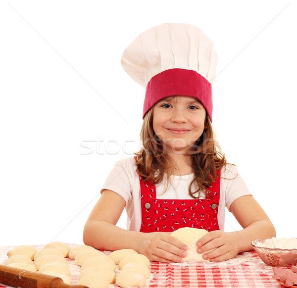 happy little girl cook kneading dough Stock photo © goce