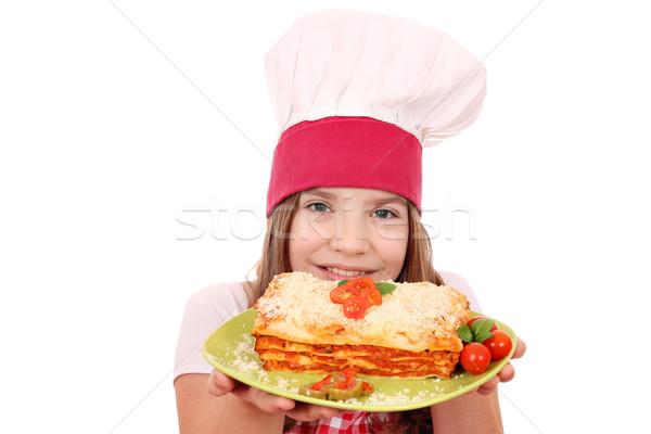 Feliz little girl cozinhar lasanha menina comida Foto stock © goce