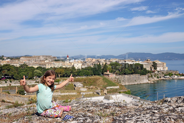 happy little girl with thumbs up in Corfu town Greece Stock photo © goce