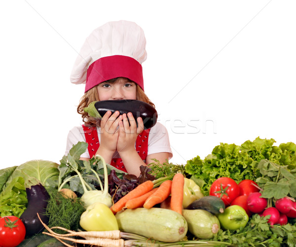 little girl cook with eggplant and vegetables Stock photo © goce