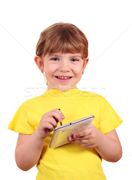 little girl with tablet pc posing Stock photo © goce