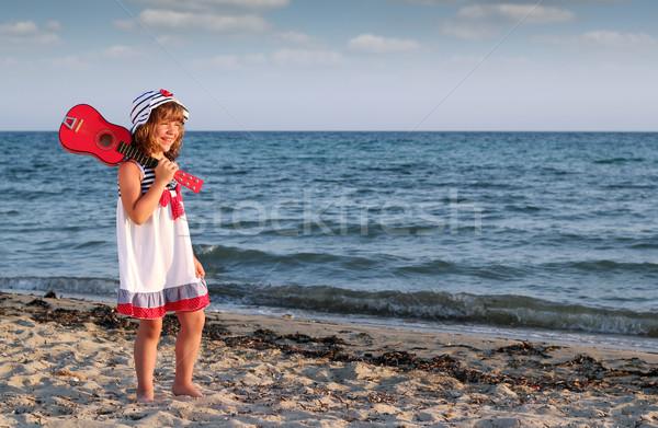 happy little girl with guitar on beach Stock photo © goce