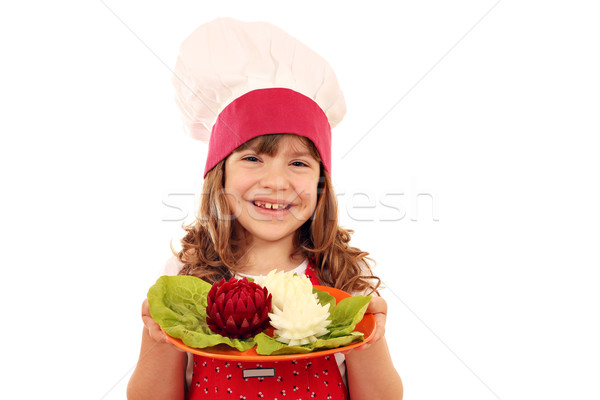 happy little girl cook hold plate with decorated salad like lotu Stock photo © goce