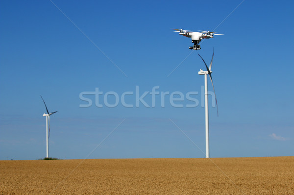 drone flying over wheat field with wind turbine summer season Stock photo © goce