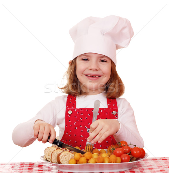 happy little girl cook with gourmet food Stock photo © goce