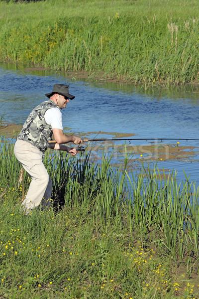 fisherman flying fishing on river recreation Stock photo © goce