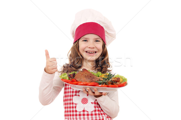 happy little girl cook with turkey drumstick and thumb up Stock photo © goce