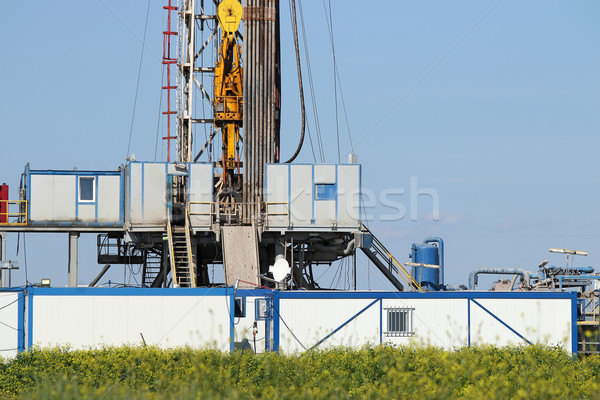Stock photo: land oil drilling rig with top drive system