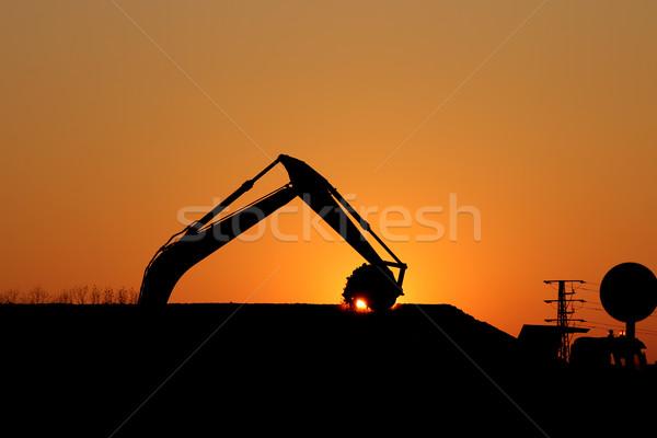 掘削機 作業 建設現場 シルエット 空 太陽 ストックフォト © goce