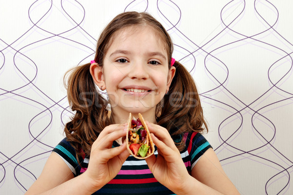 beautiful little girl with tacos  Stock photo © goce