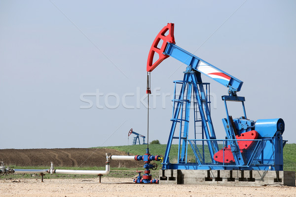 two oil pump jack on oilfield Stock photo © goce