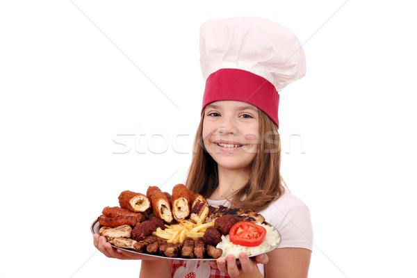 Boldog kislány szakács grillezett hús tányér gyermek Stock fotó © goce
