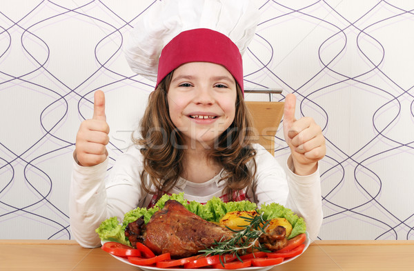 happy little girl cook with big drumstick and thumbs up Stock photo © goce