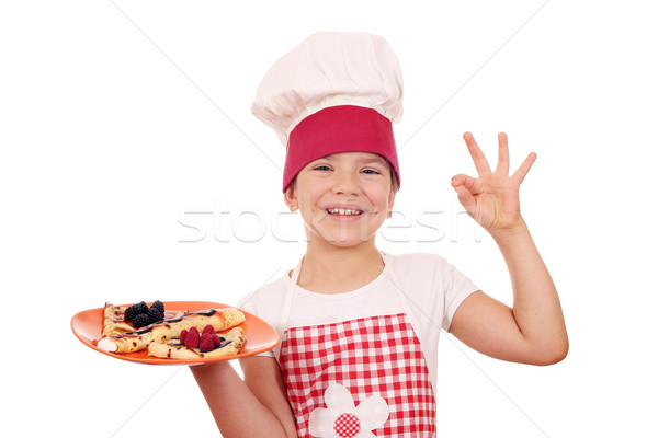 happy little girl cook with crepes and ok hand sign Stock photo © goce