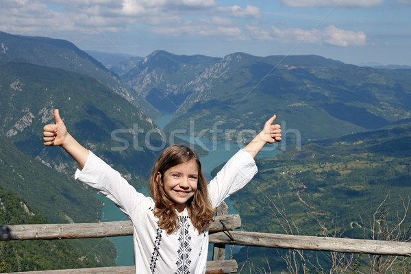 happy little girl with thumbs up on mountain top Stock photo © goce