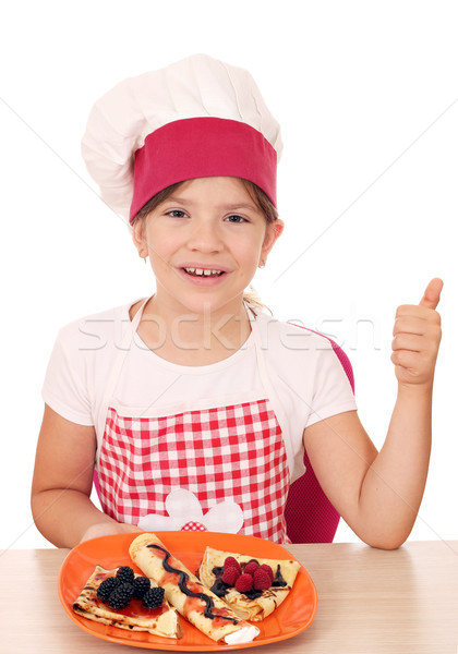 happy little girl cook with crepes and thumb up Stock photo © goce
