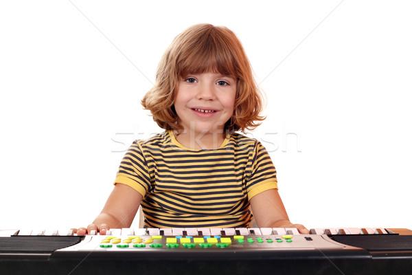 Feliz little girl jogar música teclado criança Foto stock © goce