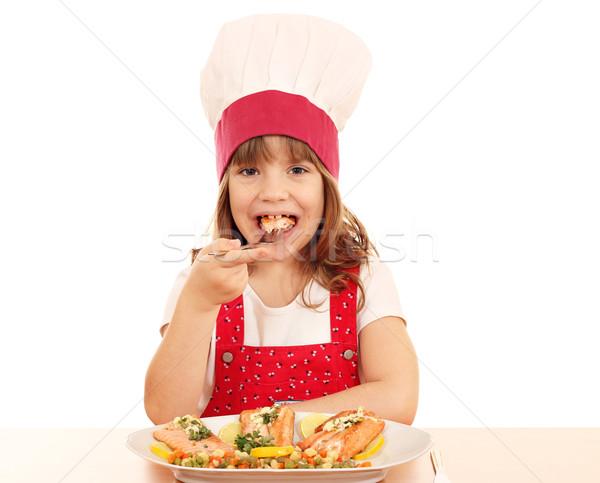 голодный девочку Кука есть лосося морепродуктов Сток-фото © goce