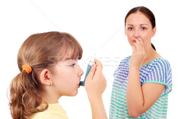 little girl using inhaler due to smoke Stock photo © goce