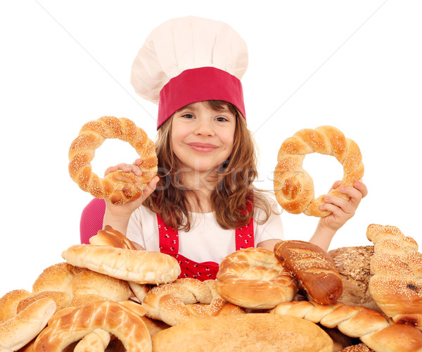 happy little girl cook with bread buns and rolls Stock photo © goce