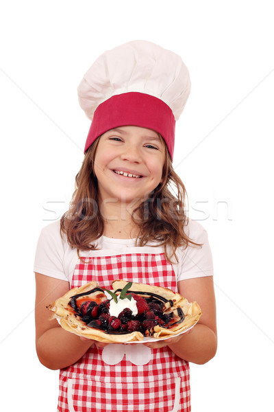 happy little girl cook hold crepes filled with fruits Stock photo © goce