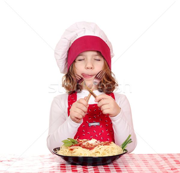 Hongerig meisje kok eten spaghetti glimlach Stockfoto © goce