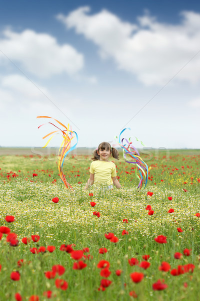 happy little girl on wildflowers meadow Stock photo © goce