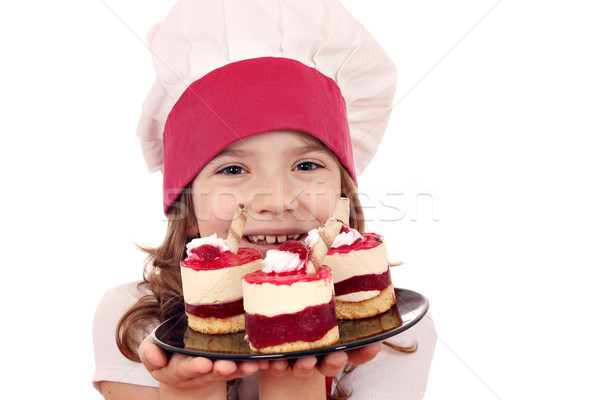 happy little girl cook with sweet raspberry cake Stock photo © goce