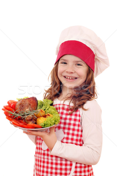 little girl cook with roasted turkey drumstick Stock photo © goce