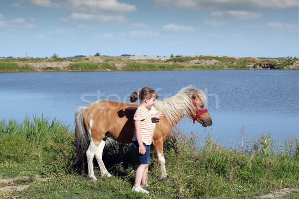 beautiful little girl with pony horse Stock photo © goce