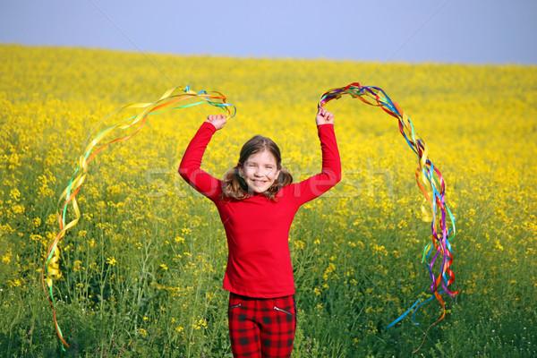 happy little girl playing on field spring season Stock photo © goce