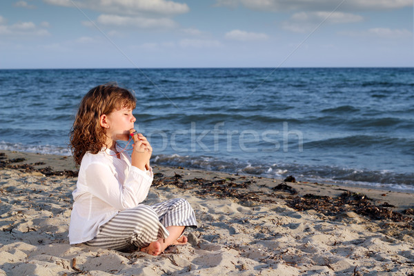 little girl play pan pipe on beach Stock photo © goce