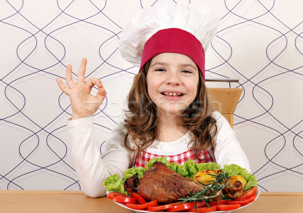 little girl cook with turkey drumstick and ok hand sign Stock photo © goce