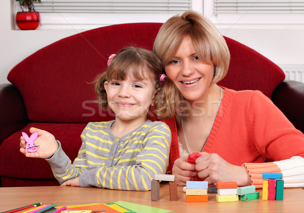 happy mother and daughter play with plasticine Stock photo © goce