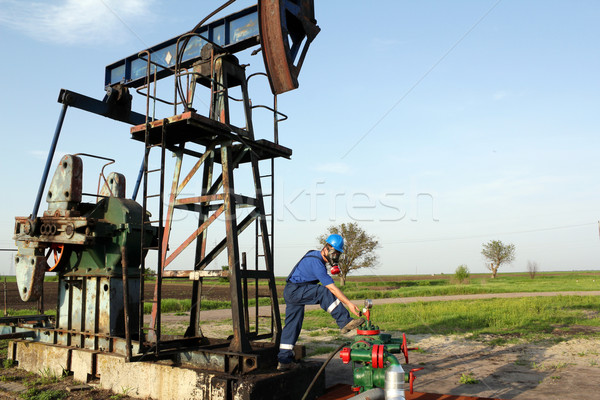 oil worker with gas mask check pipeline Stock photo © goce