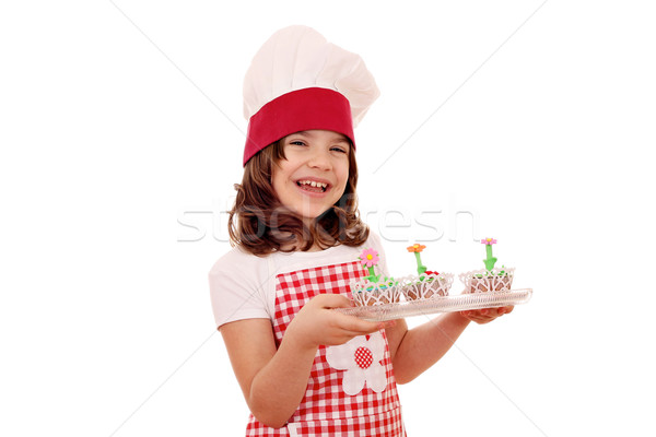 happy little girl cook with tasty spring flowers muffins Stock photo © goce