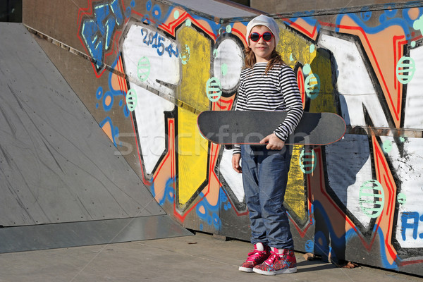 happy little girl with skateboard in skate park Stock photo © goce
