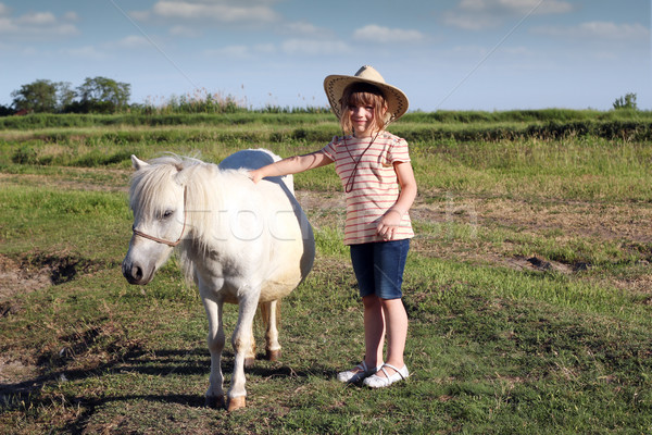 Stock photo: child little cowboy and pony horse