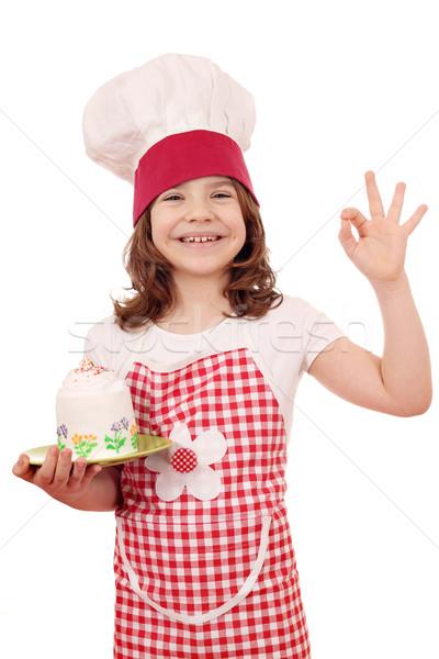 Glücklich kleines Mädchen Koch Kuchen Handzeichen Stock foto © goce
