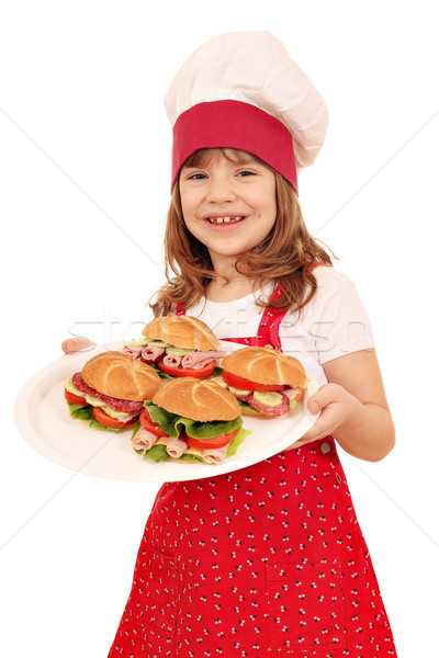 happy little girl cook hold plate with sandwiches Stock photo © goce