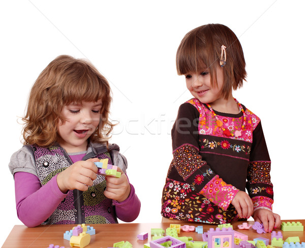 little girls play with toy blocks Stock photo © goce