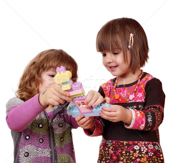 Kislányok játék jókedv építőkockák lány gyermek Stock fotó © goce