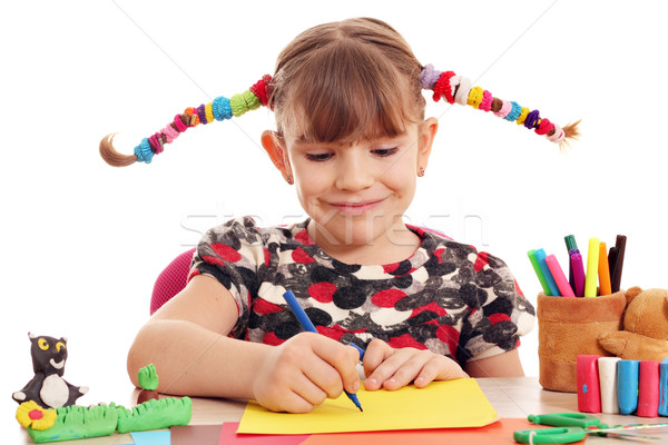 beautiful little girl with pigtails drawing Stock photo © goce