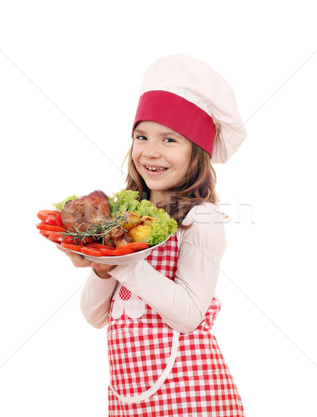 happy little girl cook with big turkey drumstick Stock photo © goce