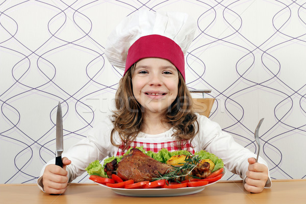 little girl cook with big turkey drumstick on table Stock photo © goce