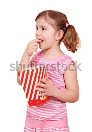beautiful teenage girl eat popcorn Stock photo © goce